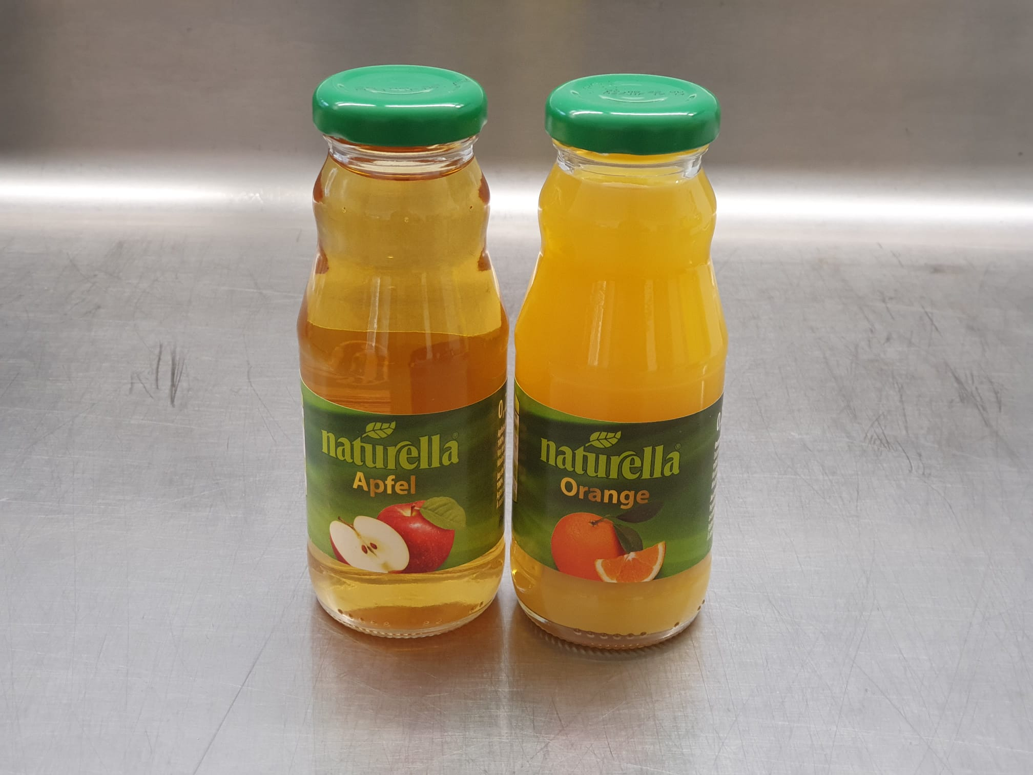 Orangen- oder Apfelsaft 0,2l